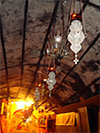 Silver filigree vigil lamps on cieling in Grotto